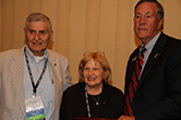 Receiving the Mackie Award for THE BOSUN�S PIPE, Ivan and Eleanor Samuels and NLUS President Jim Offutt