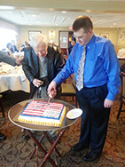 Tom Dinges and Brian Miskell cut the traditional Navy Birthday cake.