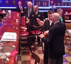 RADM Raymond Couture instructs Sea Cadet in use of Navy sword to cut the Navy Birthday cake. In the background is LCDR Coop and NL members.